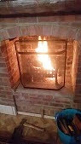 Roaring real open log fire in the winter