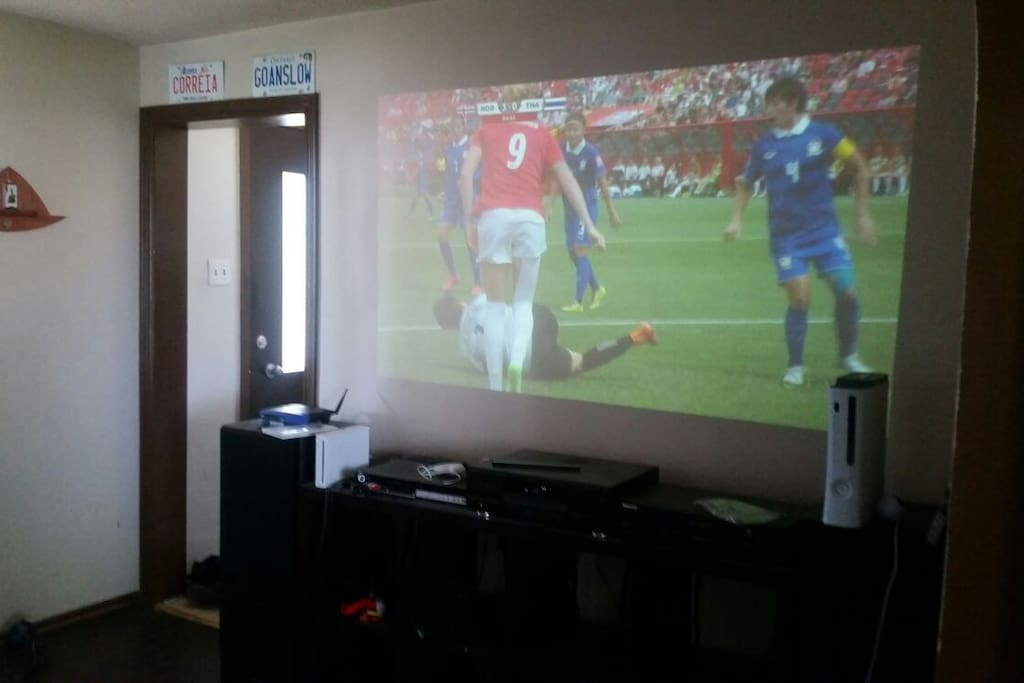 Projector in living room with 6 HD channels.