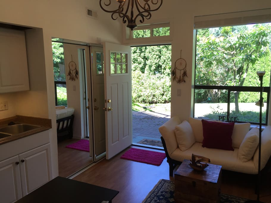 Main room with futon sofa, table & chairs & kitchenette overlooks your patio area and back garden