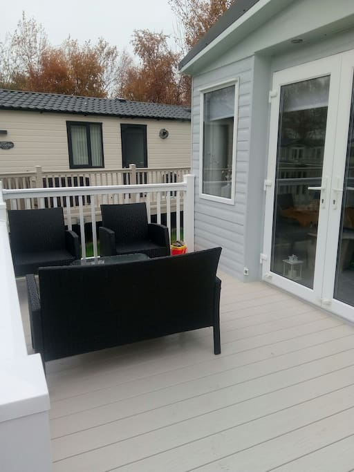 Chill out and relax on the decking, there is also a large barbeque that you can use and sun loungers