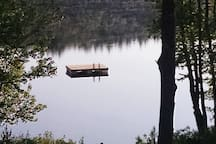 Viewed from the porch, the raft rests in solitude. It's at 8 feet deep.