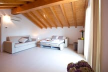 Attic room with luxury sofa bed