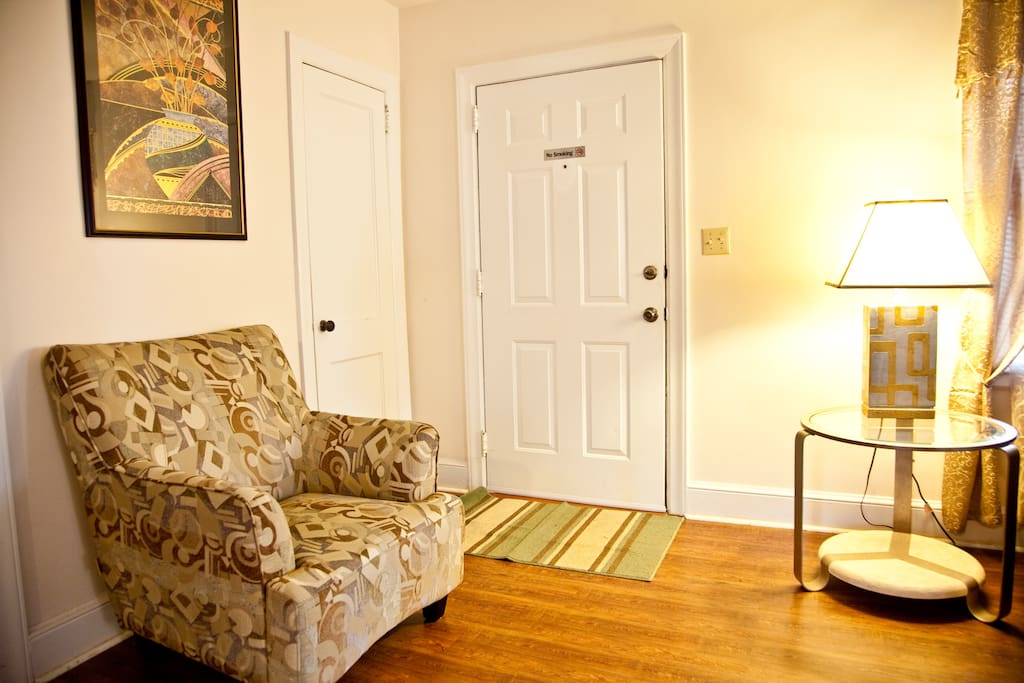 Front door and sitting area beside living room area (with front closet)