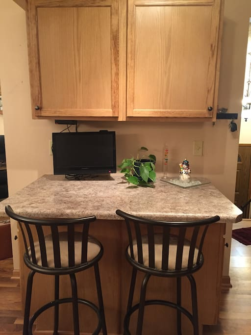 Breakfast bar/serving area in kitchen with TV