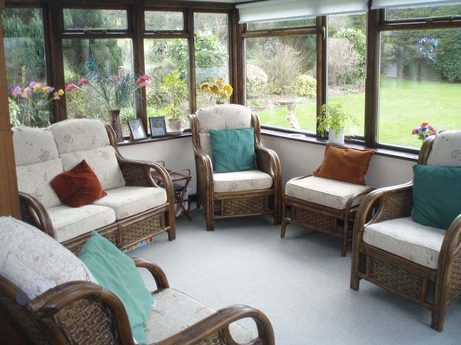 A sun lounge to sit & relax in & enjoy the large garden.