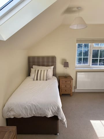 Second floor bedroom with two single beds