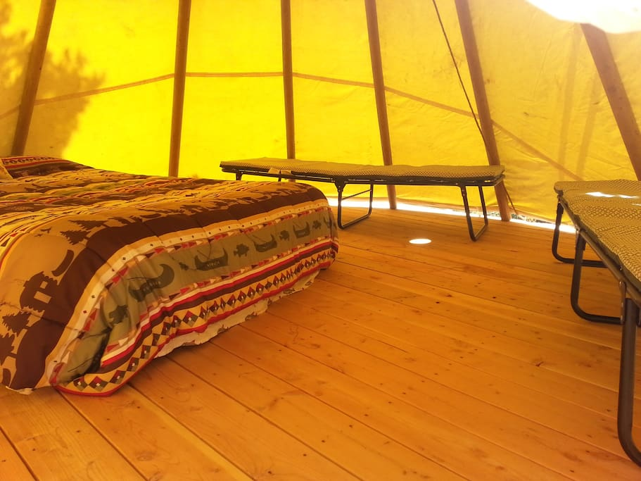 Roomy interior, queen air bed with 2 padded camp cots