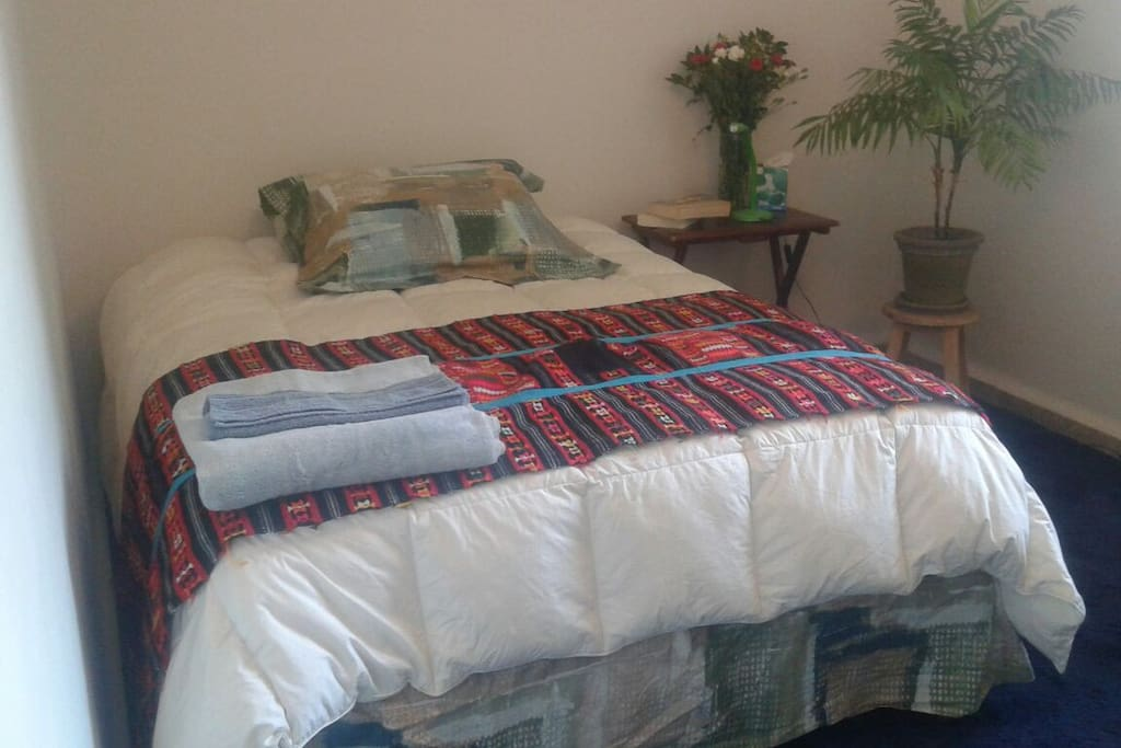 Guest's cozy and spacious bedroom with  its double bed
