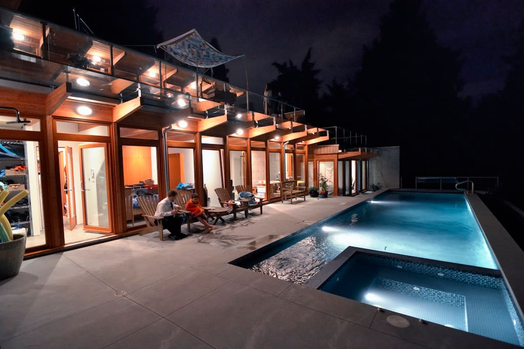 Pool and hot tub at night; owner's house (guest house in same style).