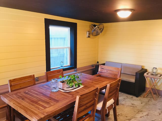 Dining table and loveseat in screened porch