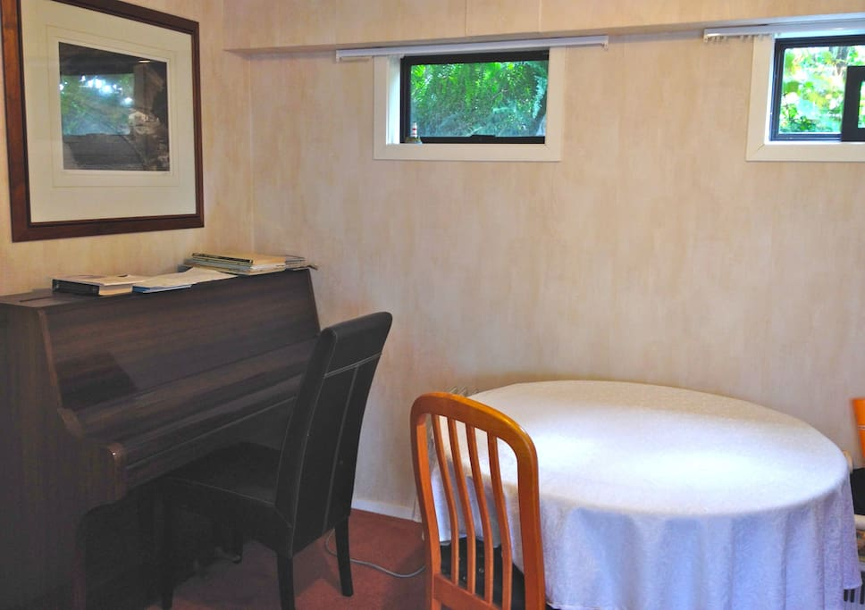 Yep, thats a piano in the sitting room and you're welcome to have a play!