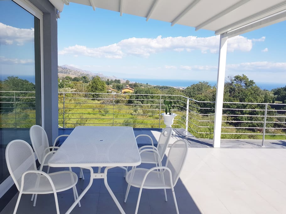 The well equipped terrace is the perfect place to dine with a view over Etna, Taormina and Mt Etna