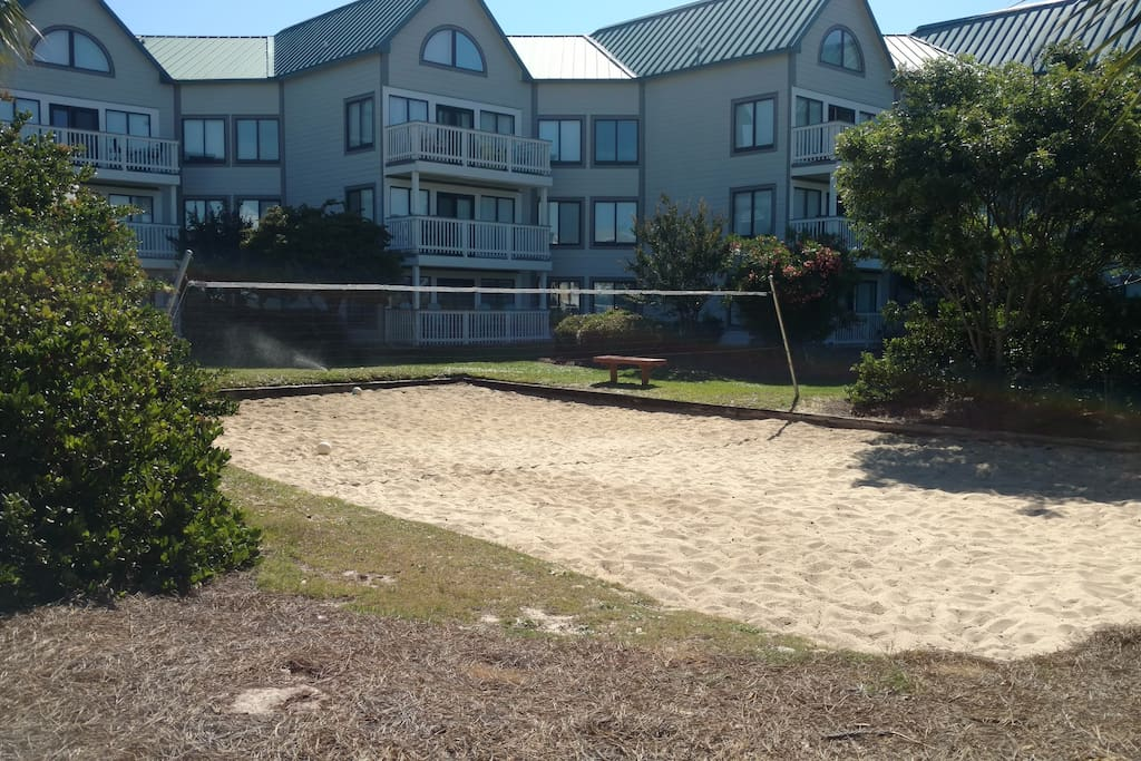 sand volley ball court right out the unit