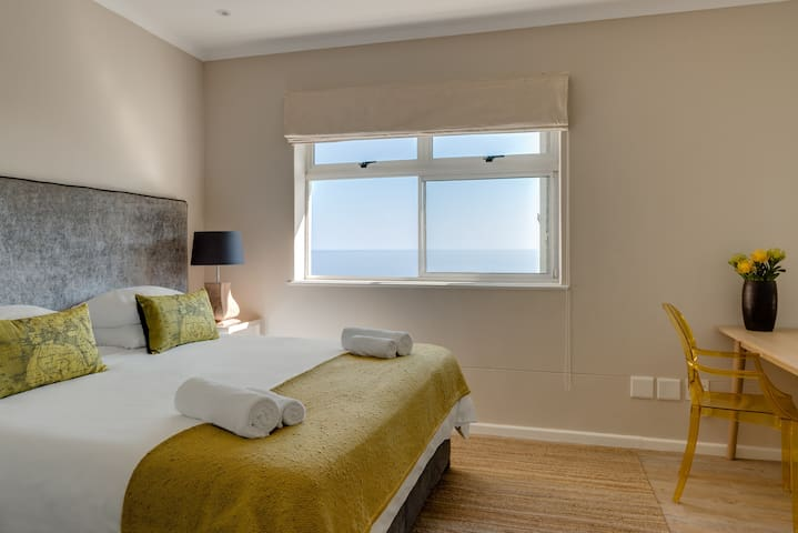 Bedroom 3 with stunning sea views. King size bed can be made up as twins on request.