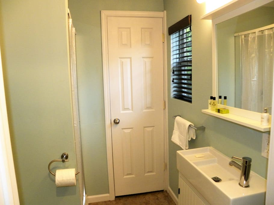 The new cute and crisp colored bathroom has a stand up shower, Ikea sink & faucet, a closet, and comes with plenty of linens, toiletries, & a blow dryer