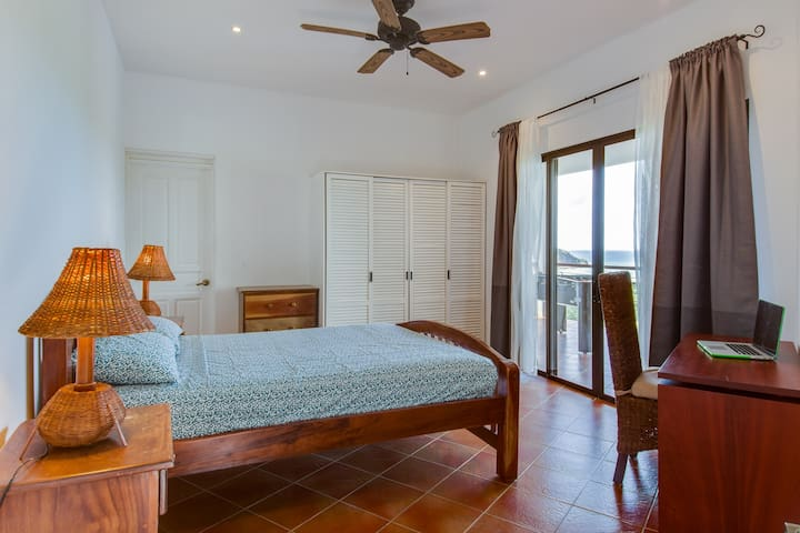 Master Bedroom #1 w/ queen bed and en suite bathroom.  All bedrooms open onto the patio with stunning Pacific views