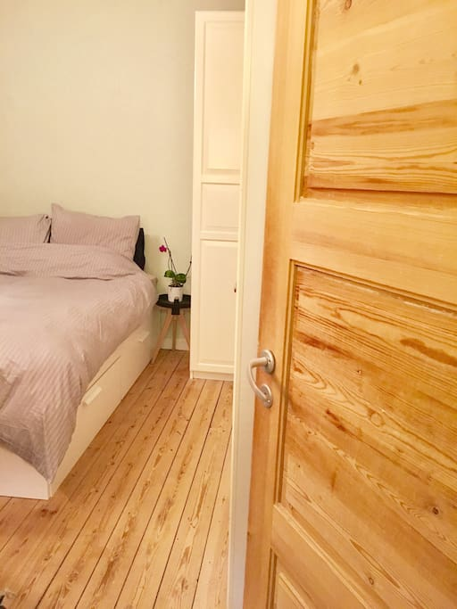 Bedroom from hallway - Big bed - notice the old original wooden planks