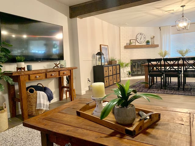 """Huge great room.  Large comfy sectional, 65"""" Smart TV, and big farm size table are perfect for family & friend gatherings."""