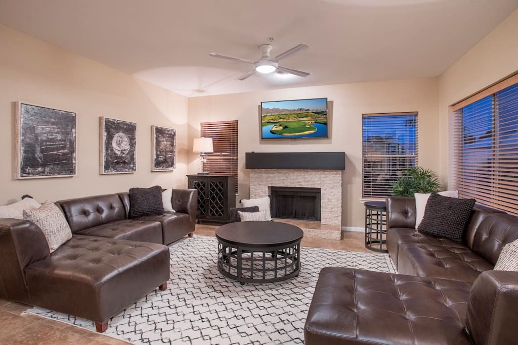 Family room with fireplace, TV and leather sectionals