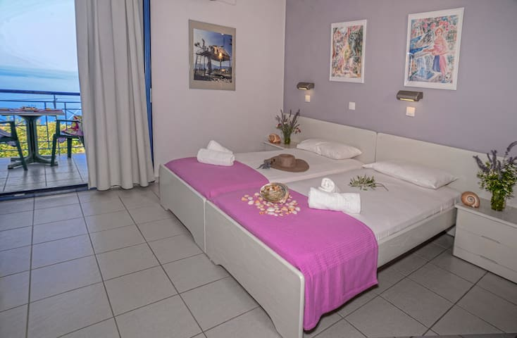 Bedroom with two single beds.All rooms have a small fully equipped kitchen and fridge
