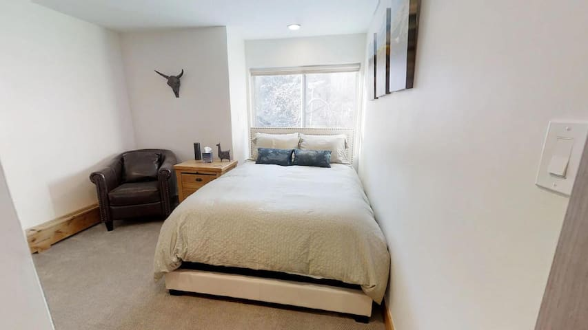 VAIL HAUS Studio Features a Queen Size Bed and Private Bathroom w/ Tub. Also Includes a Small Seating Area and an Amazon Echo for Playing Music