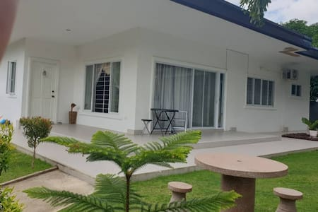 A modern White Villa with fully enclosed garden.