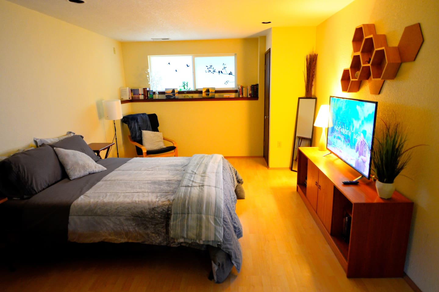 Your private, spacious sleeping area in 800 square-feet of studio suite on the lower floor of the