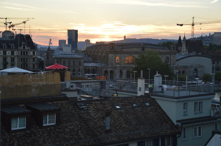 Main train station (Zürich HB) and a larger super market (Coop) can be spotted from the roof top