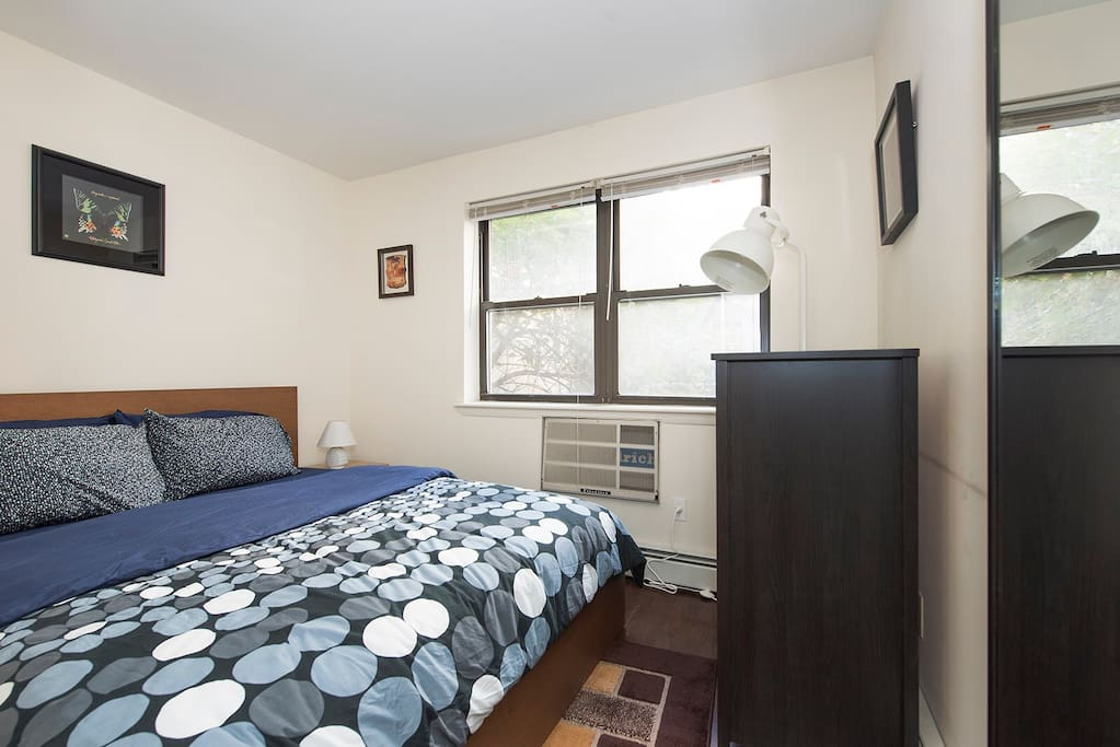 Bedroom 2 with queen-sized bed and great natural light (w/ curtains) for great sleep