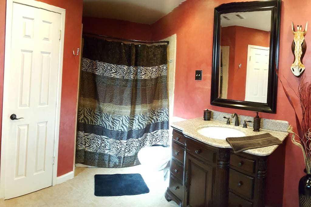 Master bathroom with double vanities and shower/ tub combination.