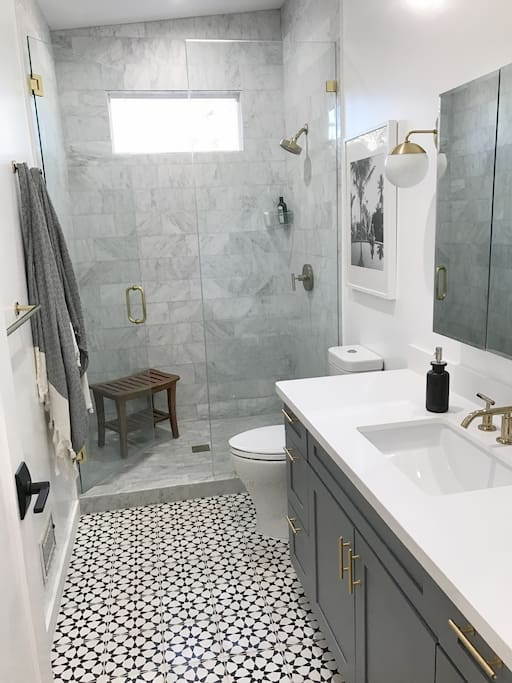Bathroom with heated flooring and carara marble tiled walk in shower