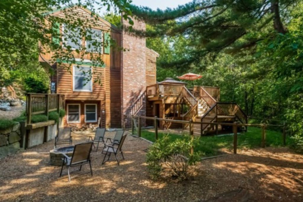 Fenced in yard, outdoor fire pit and large deck