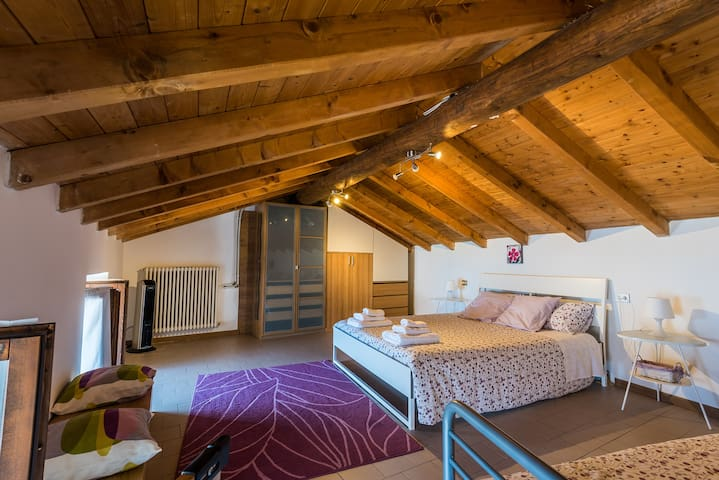 Master bedroom with wooden roof beams