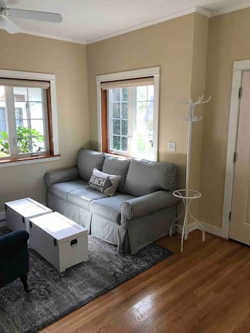 Living area/entry way (couch is a queen sized sofa bed)