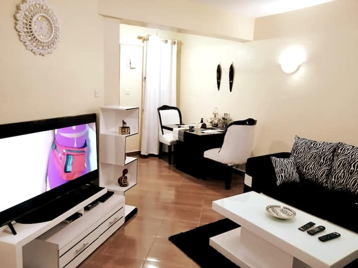 Modern African Themed Apartment Near Two Rivers