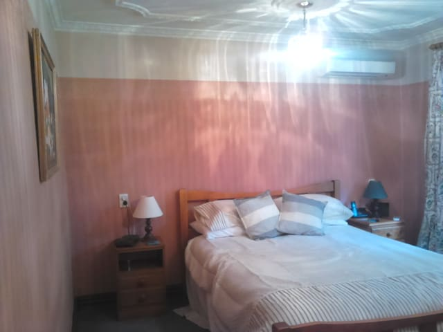 Bedroom with air conditioner. And queen bed.