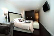 Londres 212 Departamentos de lujo Chica cama king
