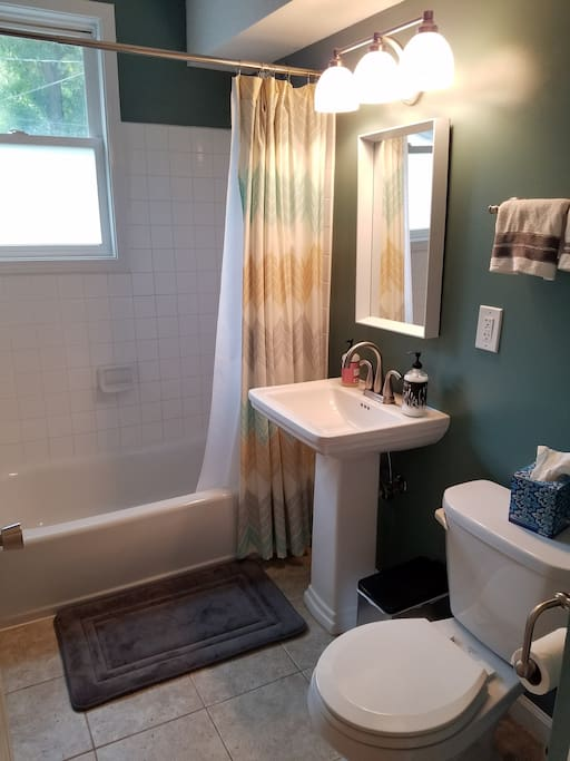 The full bath is just across the hall from your room, and comes equipped with all the travel essentials.