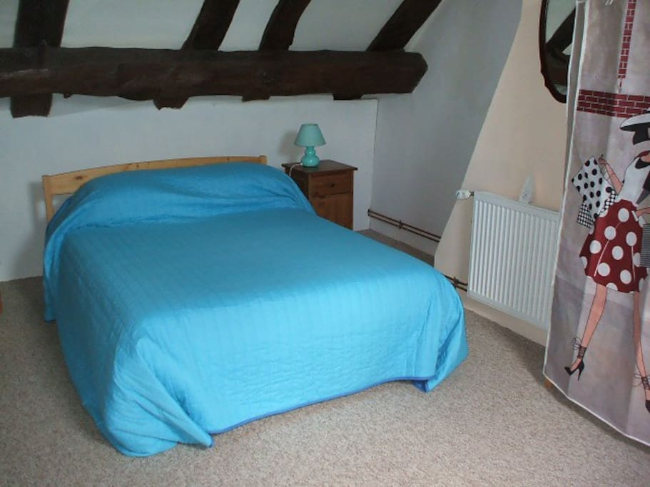 In the bedroom there is a double bed and a single bed.