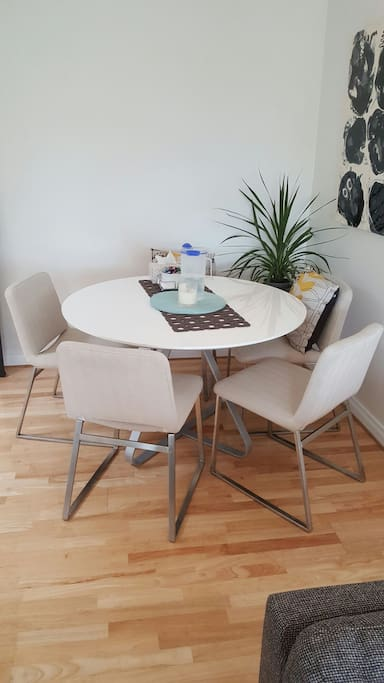 Modern dining table and comfortable upholstered chairs
