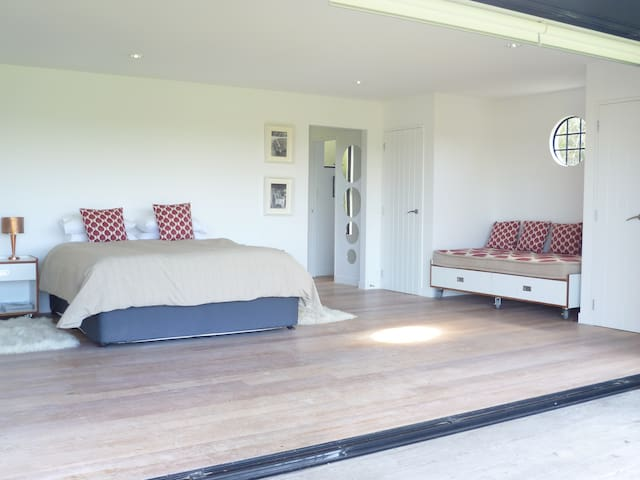 View with extra large single bed to the right