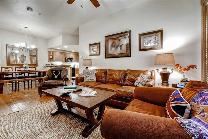 Inviting condo with shared hot tubs, pool, fitness center, steam, fire pit and ski shuttle!