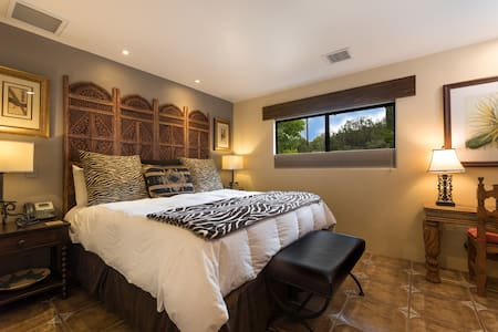 The guest bedroom has a king bed, spacious closet and iPod dock.