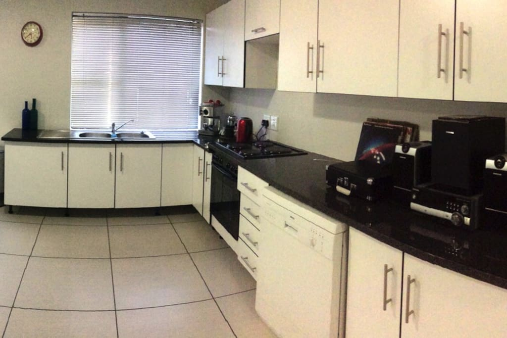 The Kitchen is clean and modern with room to cook!