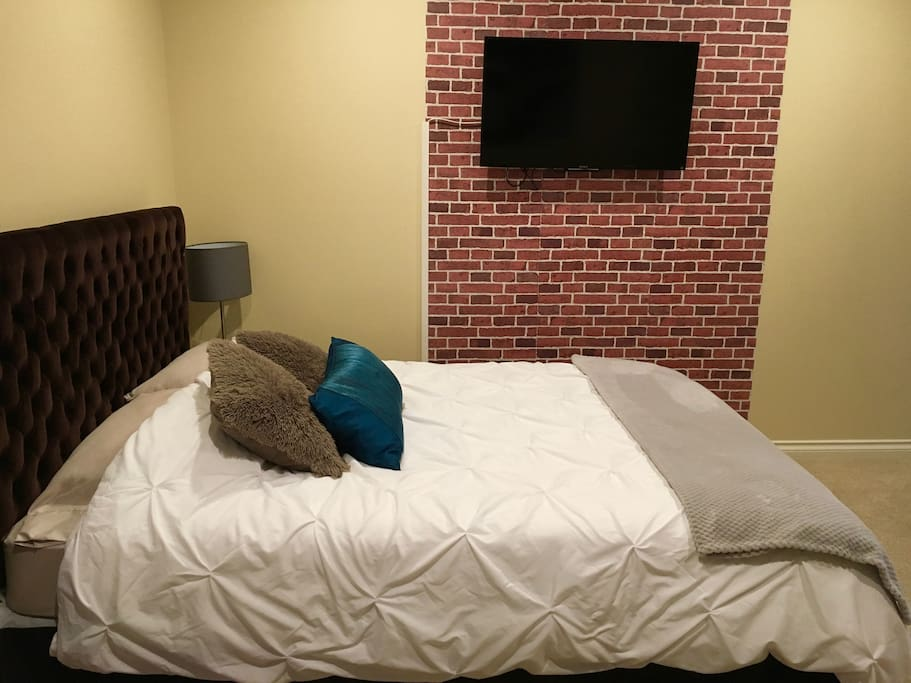 A comfortable queen size bed and TV with Netflix.