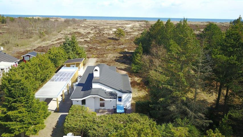 Arkitekttegnet hus med 300m til børnevenlig strand