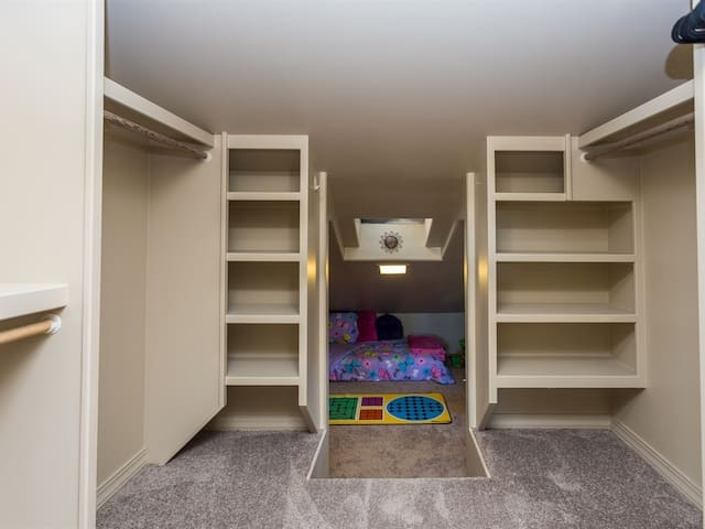 Large closet off Master Bedroom leads to surprise kiddie playhouse!
