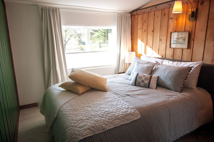 Cozy bedroom with very comfortable bed and quality linens. A closet and dresser is available for you, as well as a full length mirror.