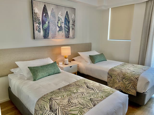 Second bedroom, with bed configuations of two king singles or a king bed. Let us know your requirements ahead of your stay and the bedroom will be made to suit.