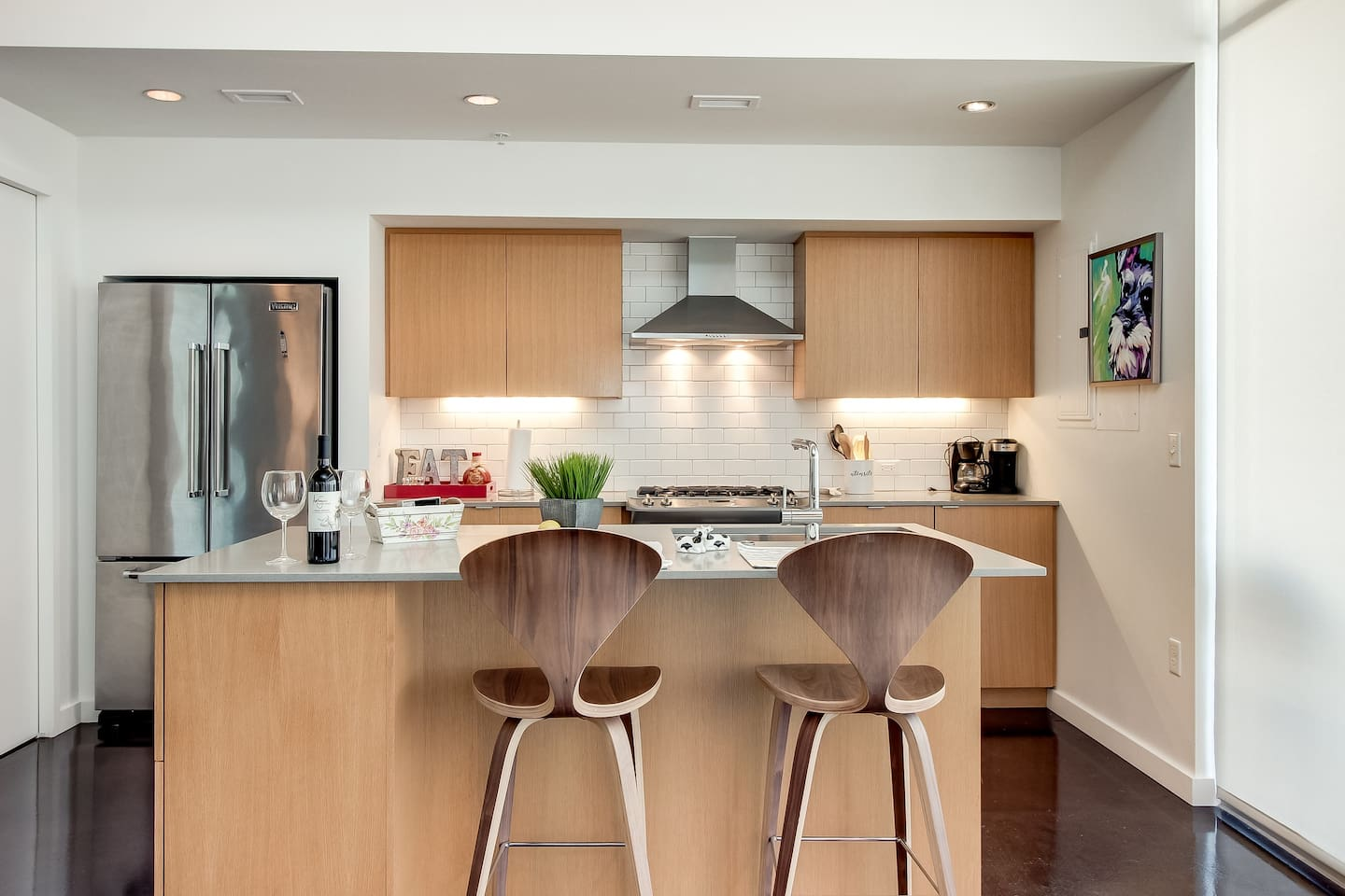 Clean kitchen with two counter stools